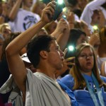 The student section waves their phones once it gets darker out. Photo by Kaitlyn Stratman
