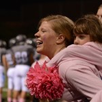 Senior Abby Hans carries a tired Little Lancer on her back during the first quarter. Photo by Katie Lamar