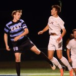 Senior Michael Mardikes heads the ball before the other team has a chance to. Photo by Morgan Browning