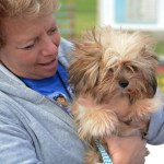 Mrs. Fishman holds a student's dog during the event. Photo by Morgan Browning