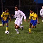 Senior Luke Ehly runs to beat two Olathe South players to the ball. Photo by Diana Percy