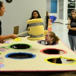 Venus Gutierrez plays Whack-a-Mole with Chemistry II students. Photo by Diana Percy