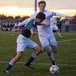 Senior Michael Mardikes puts pressure on his opponent, fighting for the ball. Photo by Kaitlyn Stratman