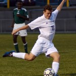Sophomore Max Maday winds up to kick the ball away from South's goal. Photo by Kaitlyn Stratman