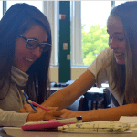 Juniors Annie Dreyer and Claire Gibbs laugh as they they work out the answer. Photo by Jemima Swindells