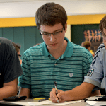 Sophomores Zach Krause, Owen Burrows and Julius Von Rautenfeld work hard on a problem. Photo by Anna Kanaley