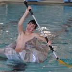 Senior Jacob Ye struggles to paddle across the pool while the boat is sinking after the races. Photo by Abby Blake.