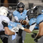 Junior Luke Kaiser prepares to hand the ball off.  Photo by Tess Iler