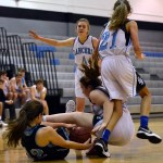 The Freshmen girls' basketball team fights for the ball. Photo by Diana Percy
