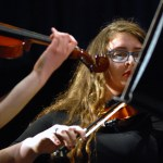 Senior Molly Mong plays the violin during the chamber orchestra's performance.  Photo by Tess Iler