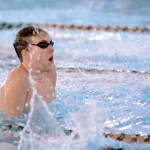 Junior Aidan Hense competes in the 100 yard breaststroke. He took third place and is two seconds away from a state cut time. Photo by Haley Bell
