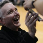 Vice Principal Jeffrey Storey shows a student the opposing team's number of fouls on his phone. Photo by Morgan Browning