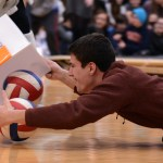 "Senior Lance Meng competes in the ""Hungry Hippo"" competition. Photo by Morgan Browning"