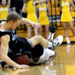 Senior Henry Sullivan falls while trying to gain possession of a loose ball.  Photo by Tess Iler