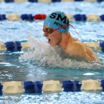 Senior Tom Peters competes in the 100 yard breaststroke. He took seventh place with a time of 1:02.17. Photo by Haley Bell