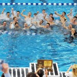 The team jumped into the pool to celebrate their win. Photo by Haley Bell