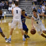 Senior Alex Glazer dribbles around the Leavenworth defense. Photo by Diana Percy