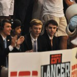 Seniors Worth Blackman, Mark Manalo, George Colby, and Matthew Erdner sit behind ESPN Gameday post and pretend to commentate the game. Photo by Carson Holtgraves