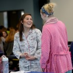 During lunch, Senior Halle Connelly and Junior Ellie Mitchell talk in their pajamas. Photo by Callie McPhail