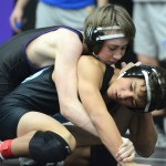 Freshman Oliver Broce pushes against his opponent to get back up. Photo by Haley Bell