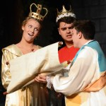 Senior Hannah Eldred, as the queen and Tyler Armer, as the king, review the menu for the royal ball. Photo by Haley Bell