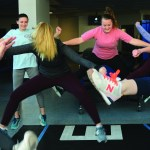 Anna and Jemima try to get some air while doing a toe touch jump.