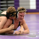 In the beginning of the match, freshman Billy Rutan is wrestled to the ground by his opponent. Photo by Morgan Browning