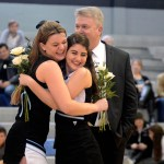 Senior Maggie Brophy hugs Junior Lilly Horton during the cheer senior night recognition.  Photo by Tess Iler