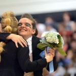 Senior Emma Olander hugs her teammate during Lancer Dancer senior night.  Photo by Tess Iler