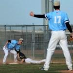 Senior Spencer Mustoe tags runner on third base Photo by Carson Holtgraves