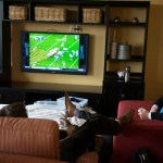 Senior Liam Griffin and other DECA members watch football to pass time between competition. Photo by Claire Pottenger