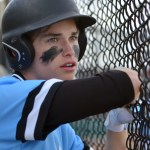 Junior Clayton Phillips watches the game in the dugout. Photo by Abby Blake