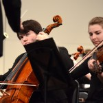 Seniors Joe Levin and Kate Hales play the Cello with the symphony orchestra. Photo by Ellie Thoma