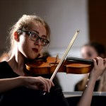 Senior Lily Wulfemeyer plays the violin during the chamber orchestra's performance.  Photo by Tess Iler