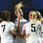 Senior Chloe Harrington celebrates the first goal of the game with her teammates. Photo by Haley Bell