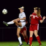 Senior Elisabeth Shook kicks the ball away from a North player. Photo by Diana Percy