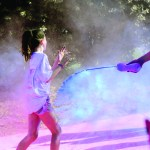Junior Chase Tetrick throws blue color powder on Color Run participant. Photo by Maddie Smiley