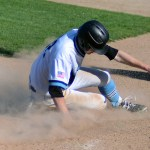 Junior Luke Anderson slides on to home base.  Photo by Kaitlyn Stratman