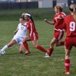 Senior Chloe Harrington pushes off a North defender. Photo by Michael Kraske