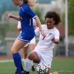Senior Georgia Weigel regains control of the ball after she trips fighting for it. Photo by Kaitlyn Stratman
