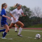 Senior Elisabeth Shook races to get to the ball during the second half of the game. Photo by Morgan Browning