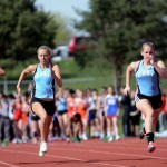 Freshman Dasha Hamilton and Junior Ramie Churchill race in the 100m dash.  Photo by Tess Iler