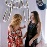 Senior Callie McPhail poses with her sister, Hannah McPhail, while taking pictures at her graduation party. Photo by Chase Tetrick