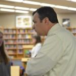 Principal McKinney listens to student.