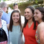 Graduate Emily Chisholm poses with her family and a family friend at her graduation party. Photo by Porter Carroll