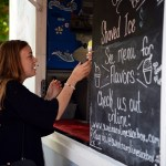 Graduate Allison Sernett orders a lemon snow cone from Sweet Carolines food truck at Carly Bird, Emily Chisholm and Claire McClelland's graduation party. Photo by Porter Carroll