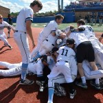 The Lancers piled up near first base after beating Lawrence Free State in extra innings. Photo by Joseph Cline