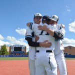 Senior Joey Wentz and junior Luke Anderson celebrate with coach Ryherd after the win. Photo by Joseph Cline
