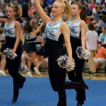 Senior Annie Smith dances to greet the students walking into the gym for the Fall Pep Assembly. Photo by Audrey Kesler