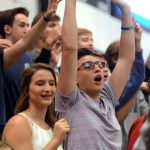 Senior Jacob Desett reaches and yells for an SME t-shirt during a t-shirt toss. Photo by Audrey Kesler